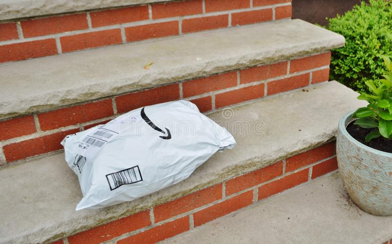 Customer Order Package Delivered to Home on Door Step royalty free stock photography