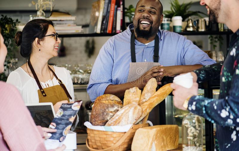 Customer ordering pastry at counter stock images
