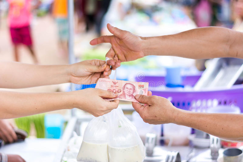 Customer paying bill by cash at market stock photos