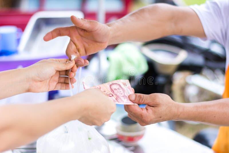 Customer paying bill by cash at market royalty free stock photo