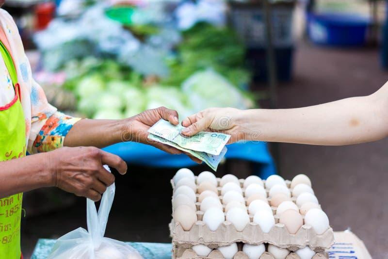 Customer paying bill by cash market stock photo