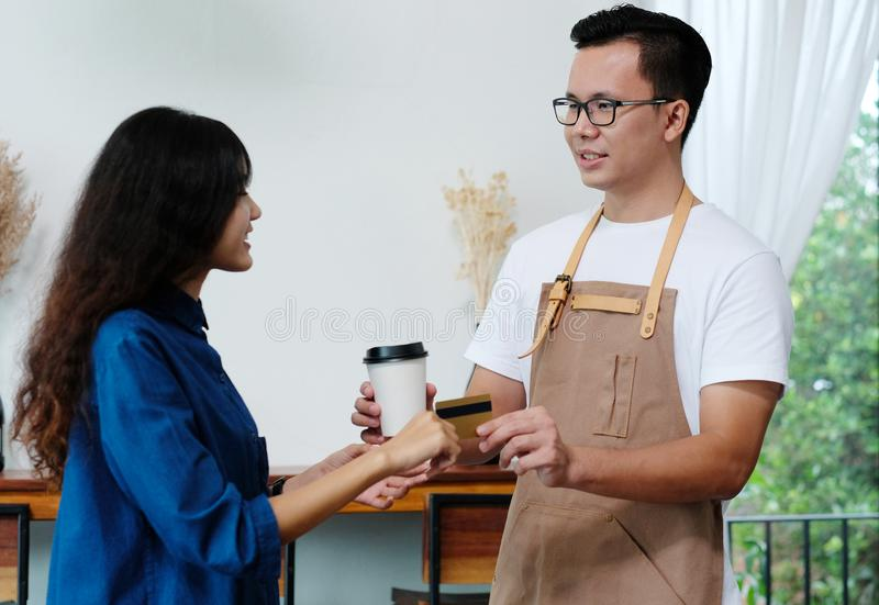 Customer paying coffee by credit card at cafe counter, food and stock images