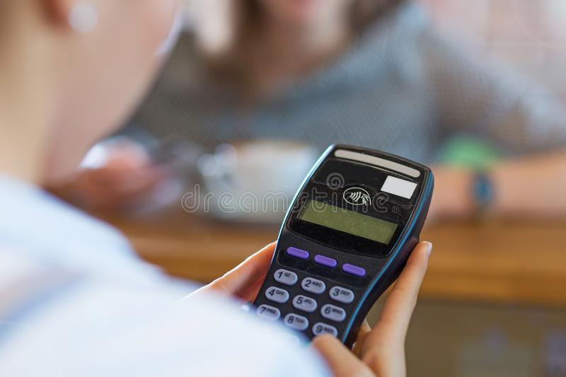 Paying for coffee. Customer Paying Through Credit Card stock images