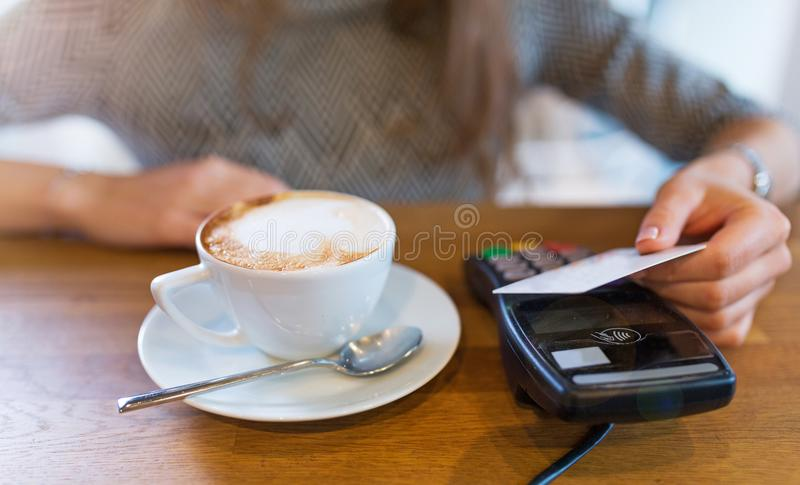 Paying for coffee. Customer Paying Through Credit Card stock image