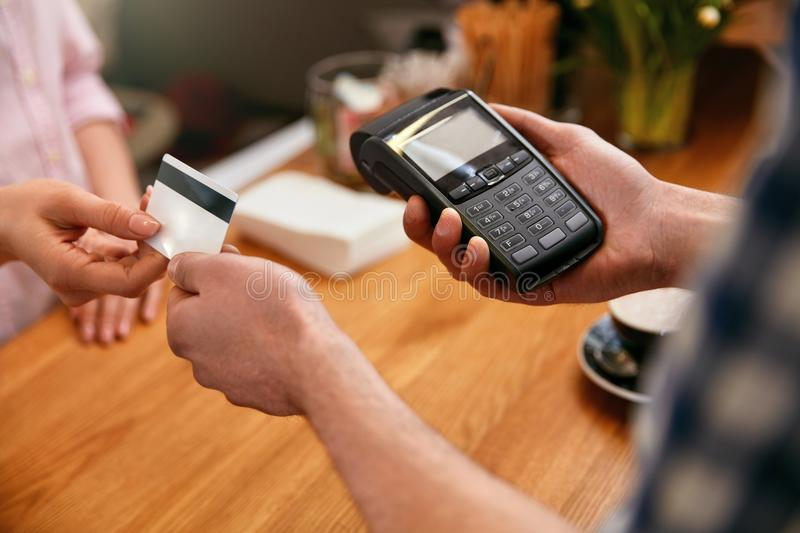Customer Paying With Credit Card In Coffee Shop Closeup. High Resolution stock photo