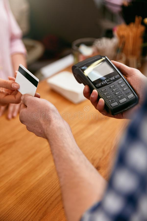 Customer Paying With Credit Card In Coffee Shop Closeup royalty free stock photos