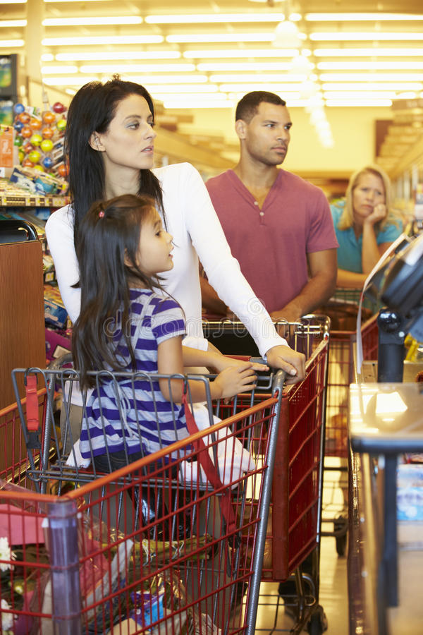 Customer In Queue To Pay For Shopping At Supermarket Checkout stock photos