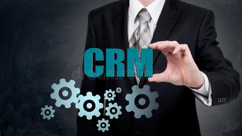 Customer relationship management concept man selecting CRM/ stock image