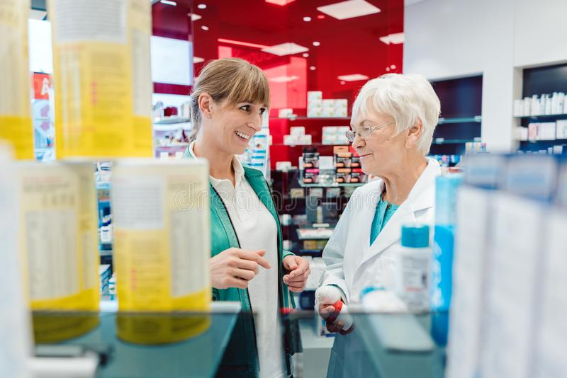 Customer and sales woman in drug store royalty free stock images