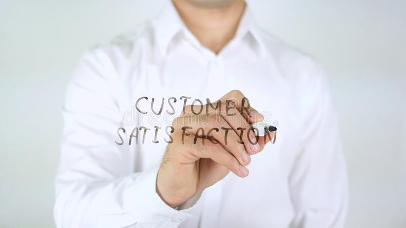 Customer Satisfaction, Man Writing on Glass royalty free stock image