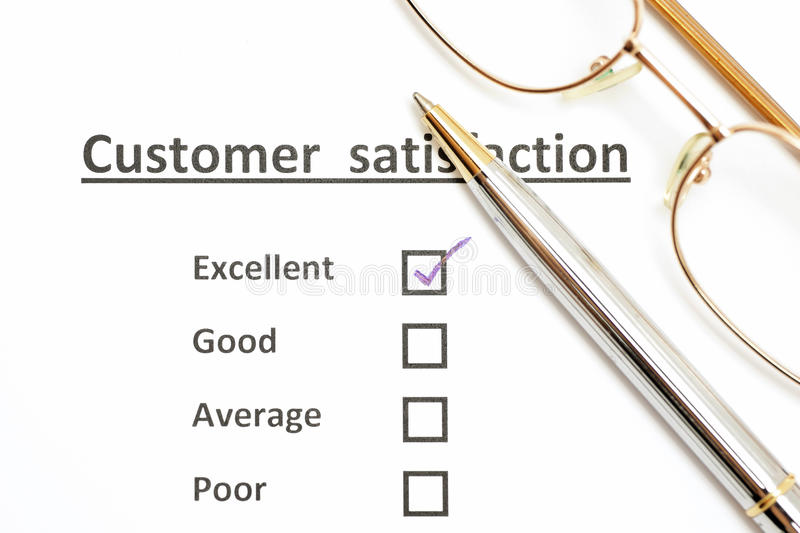 customer satisfaction survey form with the pen checked