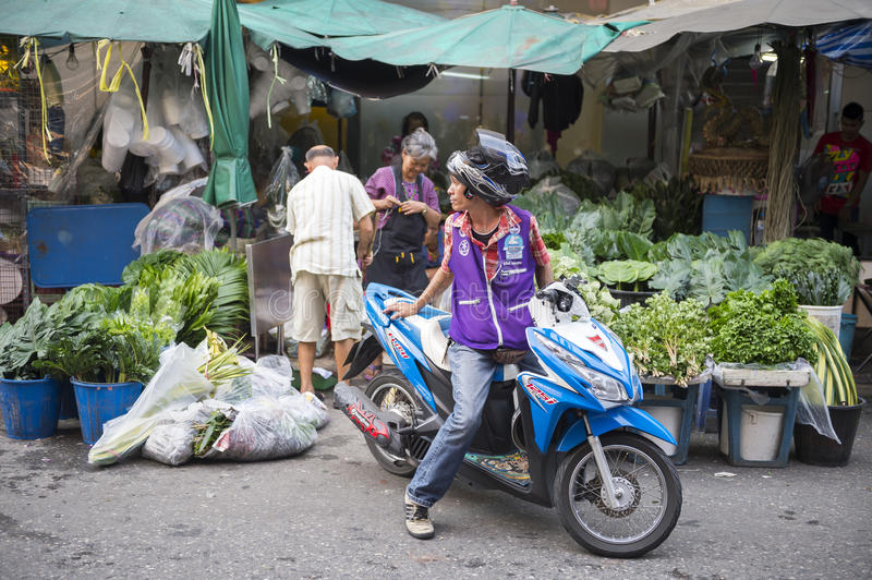 Customer on Scooter Thai Vegetable Market royalty free stock photo