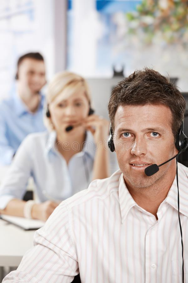 Customer service. Portrait of customer service operator talking on headset, smiling royalty free stock images