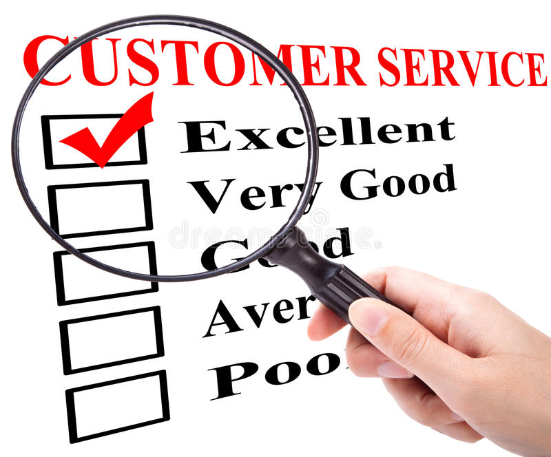 Customer service. Customer satisfaction filled out form with excellent and a magnifier glass in a hand stock photos