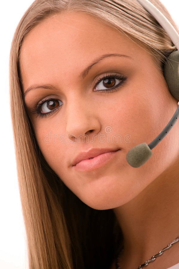 Customer Service. Happy young customer service girl in headset smiling royalty free stock photo