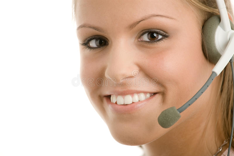Customer Service. Happy young customer service girl in headset smiling royalty free stock image