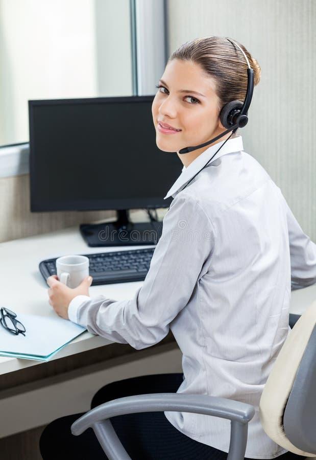 Customer Service Agent At Computer Desk Stock Photo