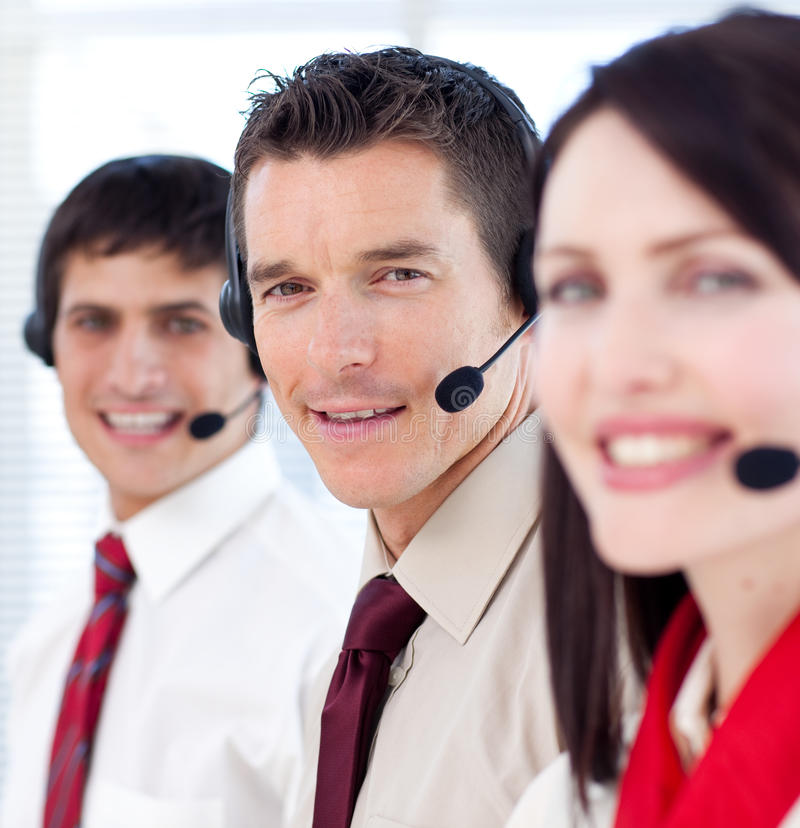 Customer service agents with headsets on stock image