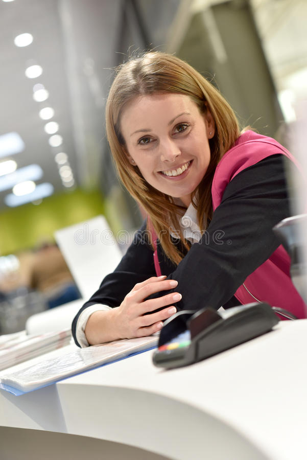 Customer service assistant in supermarket stock images