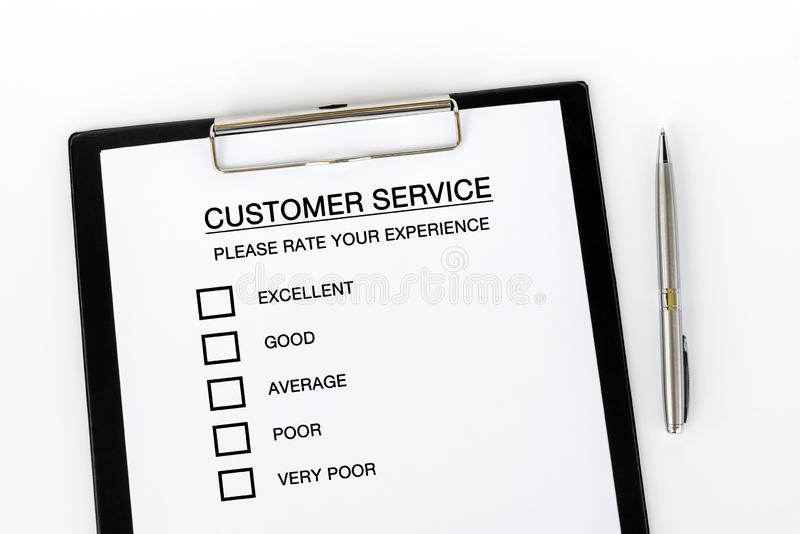 Customer Service Checklist. On attached on Clip board and pen on white background royalty free stock photos