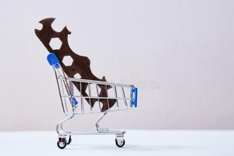 Customer service and client support concept. Home servises. Wrench in the shopping cart.  royalty free stock photos