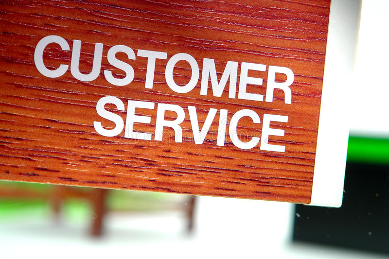 Customer Service Department Sign. Customer service sign on the glass door of a corporate office help desk department stock photos