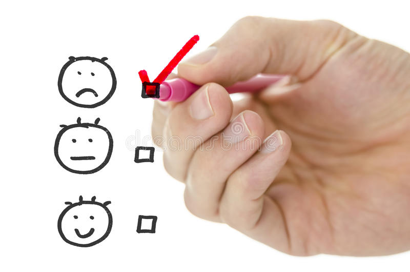Customer service evaluation form. With male hand drawing pink check mark on poor stock photography