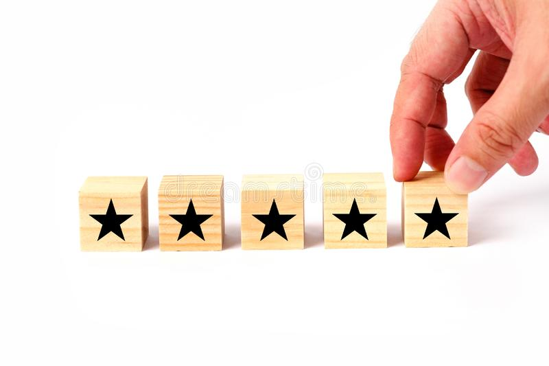 Customer service evaluation and satisfaction survey concept with stars for rating. Customer service evaluation and satisfaction survey concept with stars and royalty free stock photos