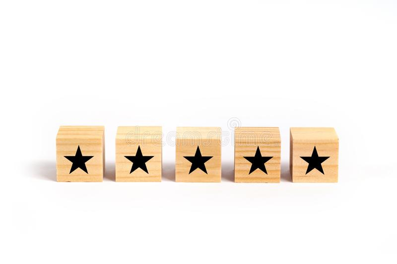 Customer service evaluation and satisfaction survey concept with stars for rating. Customer service evaluation and satisfaction survey concept with stars on royalty free stock photo