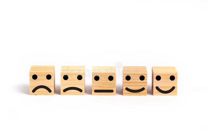 Customer service evaluation and satisfaction survey concept. Customer service evaluation and satisfaction survey concept with wooden blocks stock photos