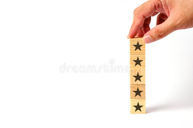Customer service evaluation and survey concept. With wooden block stacked vertically stock images