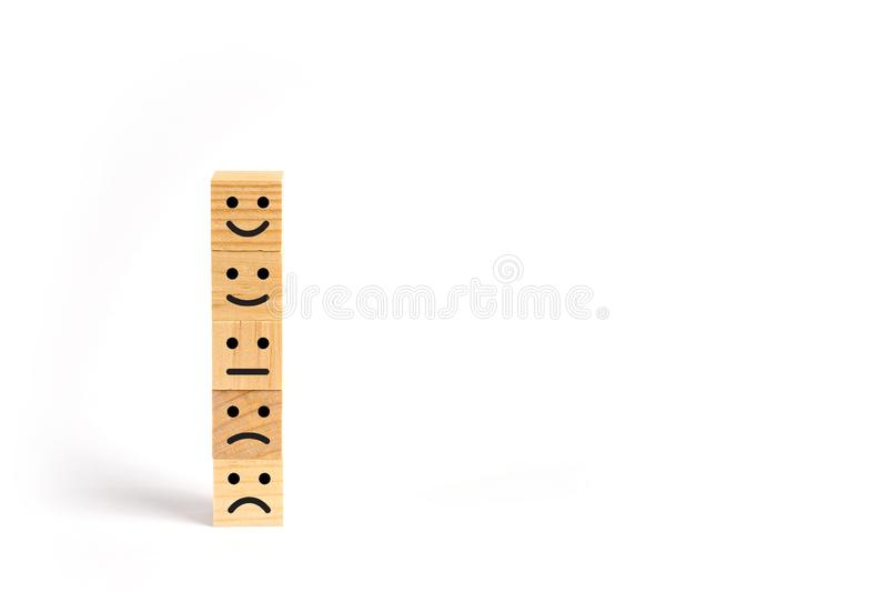 Customer service evaluation and survey concept. With wooden block stacked vertically royalty free illustration