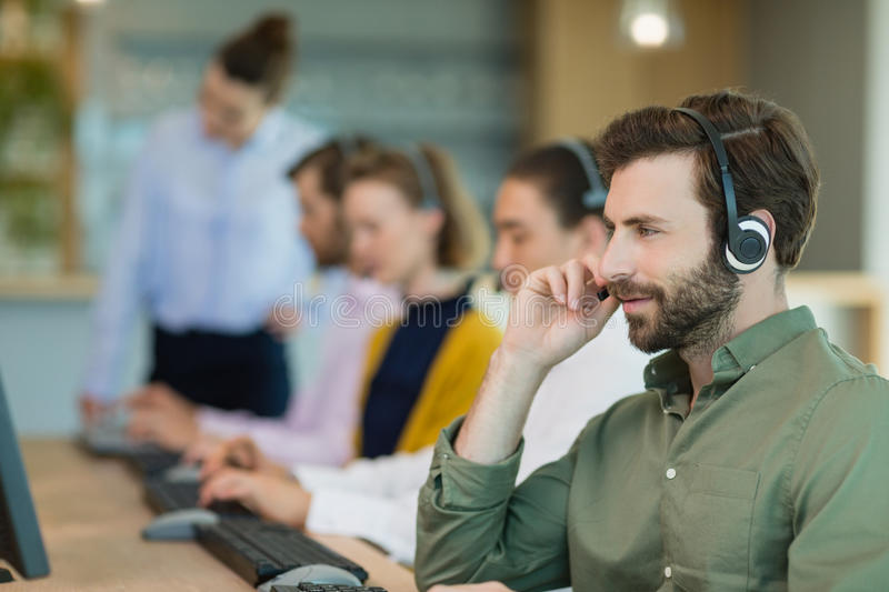 Customer service executives working in call center royalty free stock photos