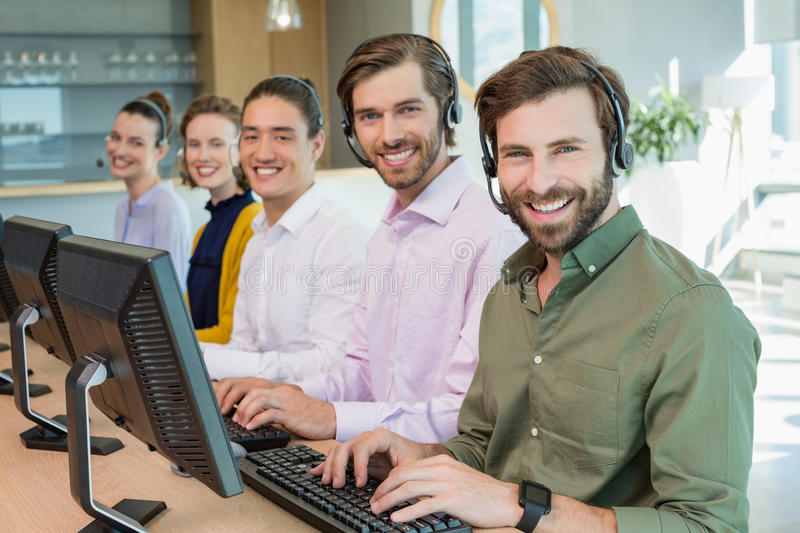 Customer service executives working in call center stock photo