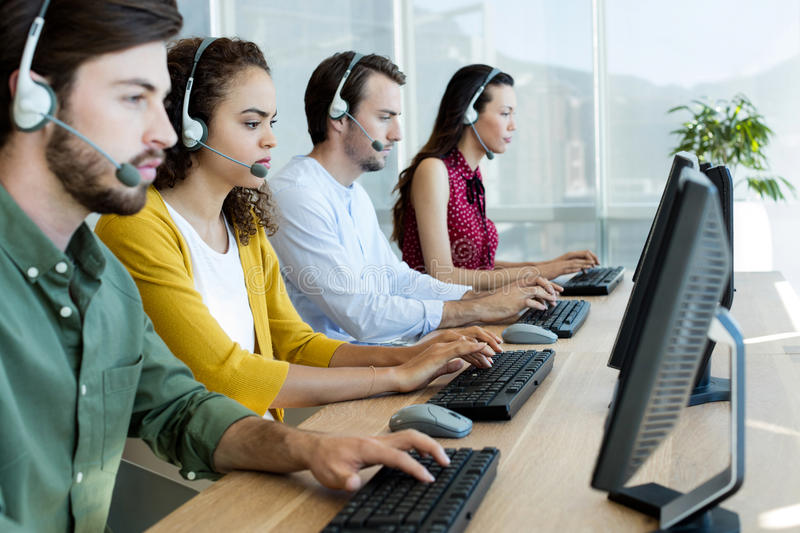 Customer service executives working stock photo