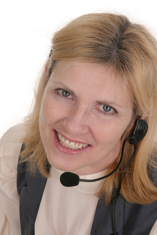 Customer Service Operator 7115. Attractive, smiling, customer service operator representative with telephone headset royalty free stock photography