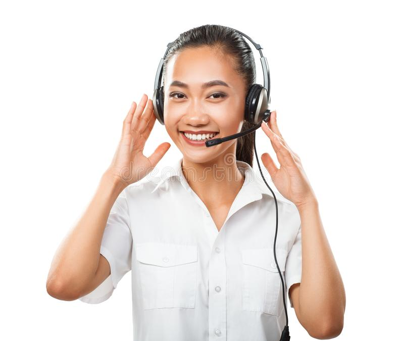 Customer service operator young Asian woman with headset isolated stock photography