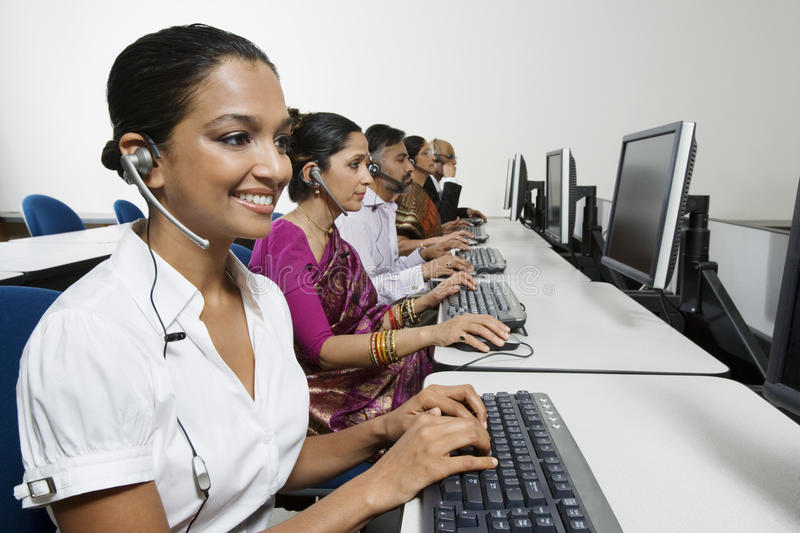 Customer Service Operators Working In Office stock photos