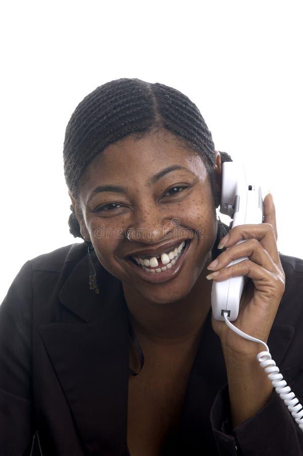 Customer service represenatative beautiful smiling on phone. Beautiful black woman customer service on telephone happy smiling royalty free stock image