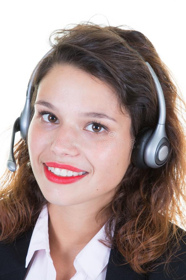 Customer service representative smiling young businesswoman with headset earpiece in office royalty free stock photography