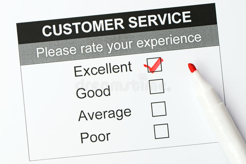 Customer service satisfaction survey form. Tick placed in excellent checkbox on customer service satisfaction survey form royalty free stock photo