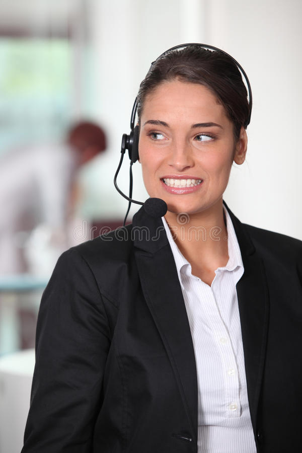 Customer service woman. A Customer service woman smiling stock images