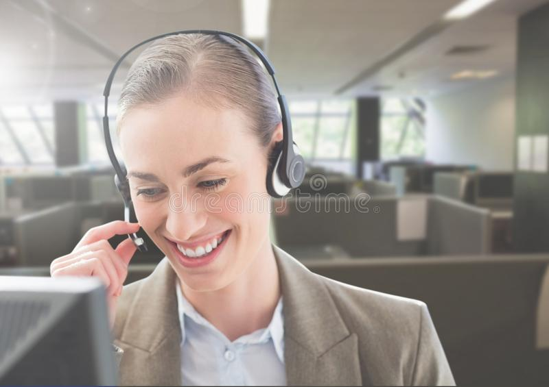 Customer service woman talking on headphone in office royalty free stock photo