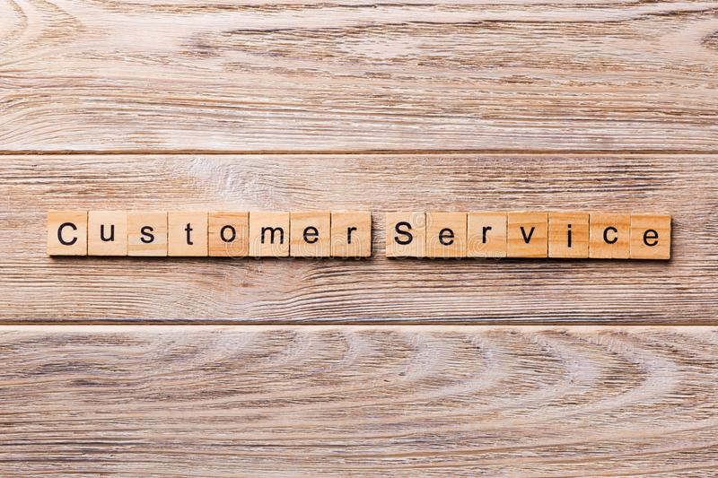 Customer service word written on wood block. customer service text on wooden table for your desing, concept stock photography