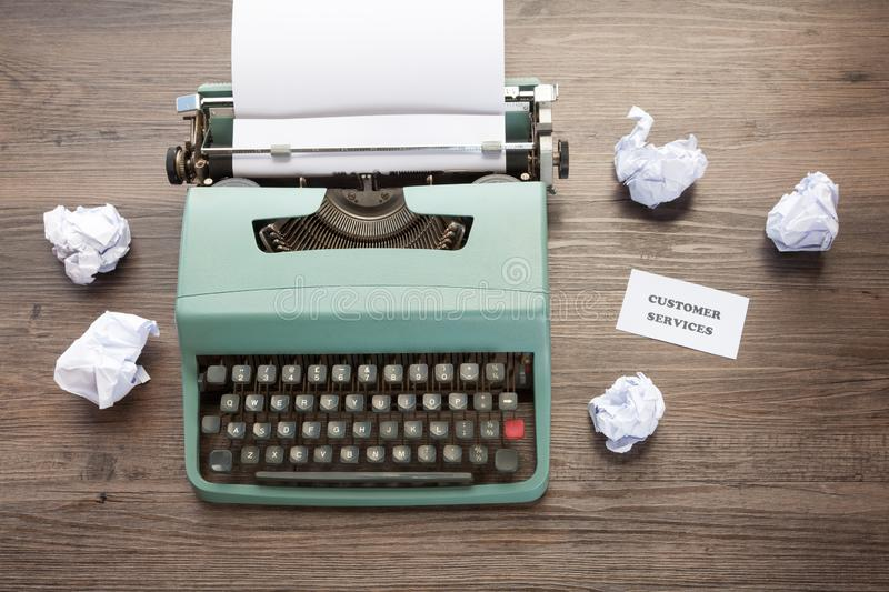 Customer Services Concept with old fashioned typewriter. Customer Services Concept - Old fashioned typewriter with screwed up paper and notice which reads royalty free stock image