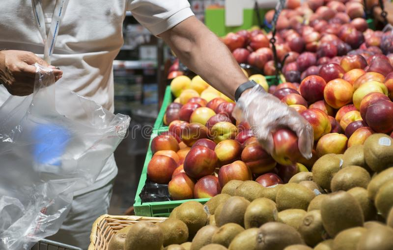 Fruit self-service in a supermarket royalty free stock photos