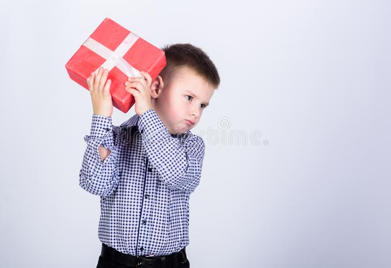 Customer. Shopping. Boxing day. New year. little boy with valentines day gift. shop assistant. Happy childhood. happy. Child with present box. Christmas stock images