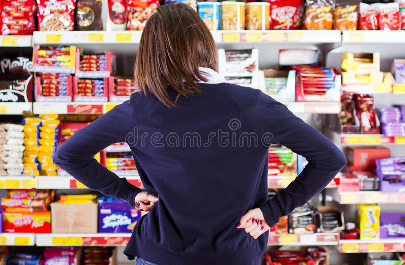 Customer shopping in grocery store stock images