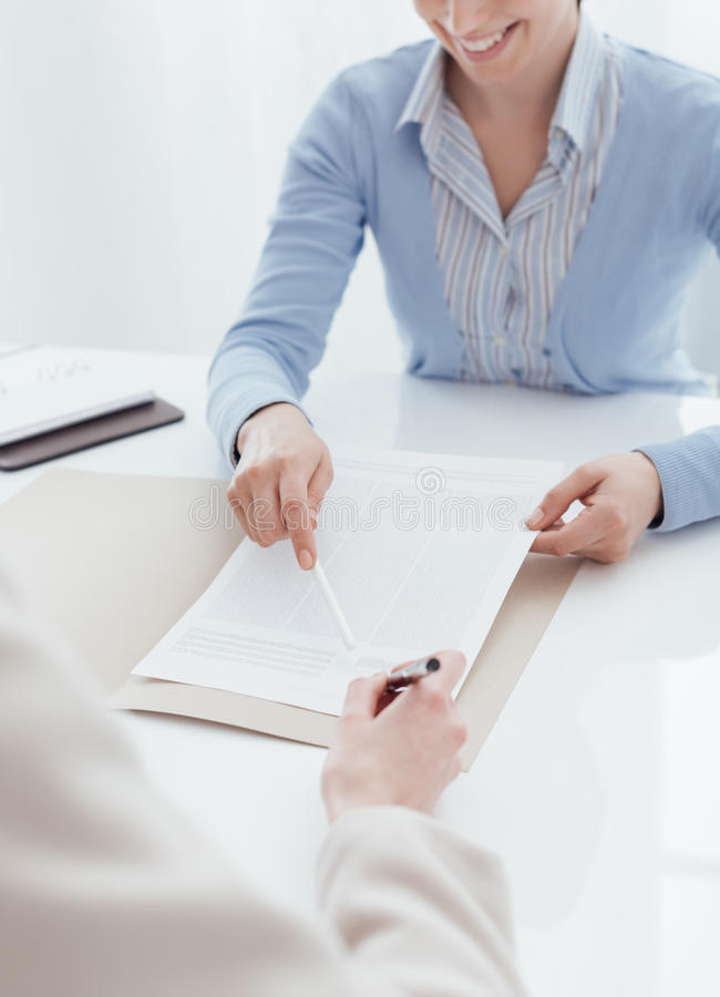 Customer signing a contract royalty free stock images