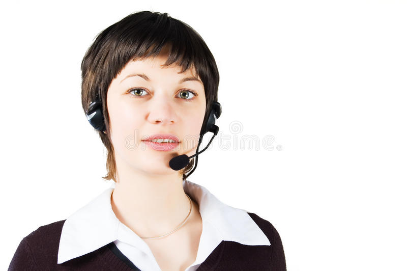 Customer support girl in call center. With headphones and microphone. Looking at customer stock photo